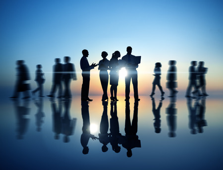 group cooperation: Group People Silhouette Gathering Sunrise Concept Stock Photo