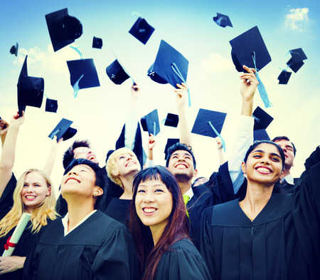 high end: Graduation Students Success Education Happiness Concept Stock Photo