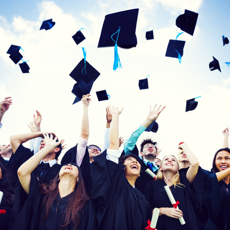 mortar board: Graduation Caps Thrown Happiness Success Cocnept Stock Photo