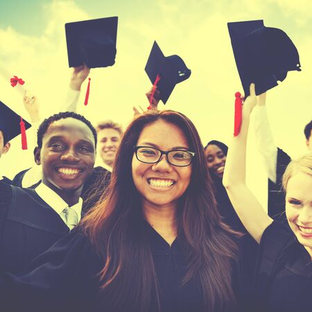 diverse students: Group of Diverse Students Celebrating Graduation Concept Stock Photo