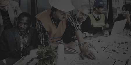 construction team: Architects and Designers Working in the Office Concept Stock Photo