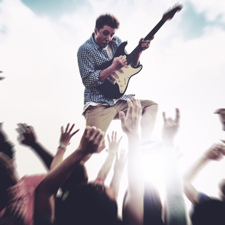 ecstatic: Young Man Guitar Performing Concert Ecstatic Crowds Concept Stock Photo