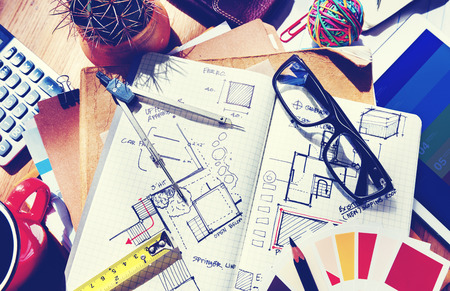 interior designer: Messy Designers Table with Sketch and Tools