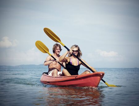 recreational pursuit: Kayaking Adventure Happiness Recreational Pursuit Couple Concept Stock Photo