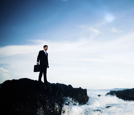 man standing alone: Businessman Staying Alone on the Island Concept