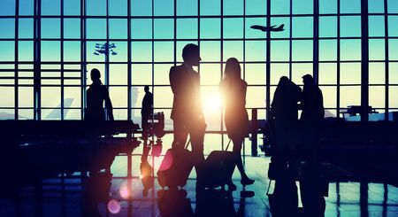 middle eastern ethnicity: Back Lit Business People Traveling Airport Passenger Concept
