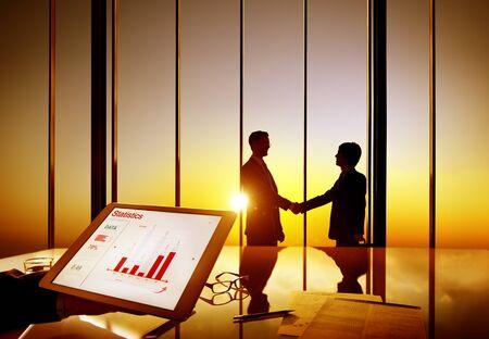 shaking: Businessmen Shaking Hands Information Data Shake Concept