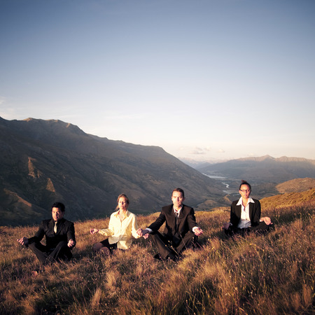Business People Meditating Mountain Outdoors Concept Stock Photo