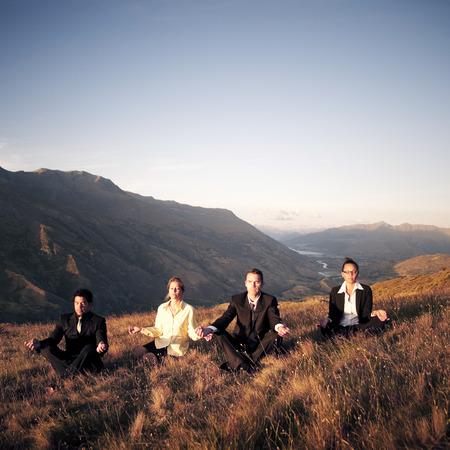 meditation man: Business People Meditating Mountain Outdoors Concept Stock Photo