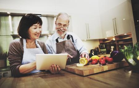 Husband Wife Cooking Searching Menu Tablet Concept Reklamní fotografie
