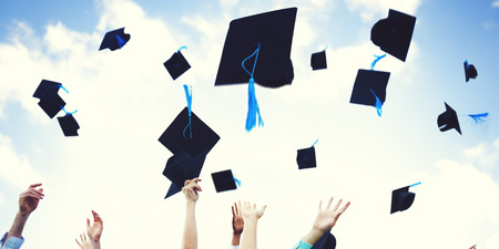 alumni: Graduation Caps Thrown Happiness Success Cocnept Stock Photo