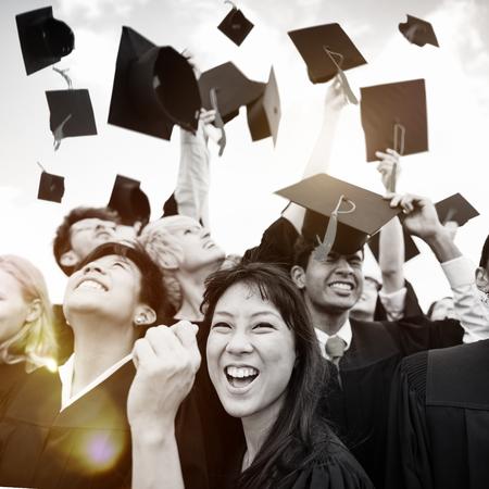 alumni: Graduation Caps Thrown in the Air Celebration Concept