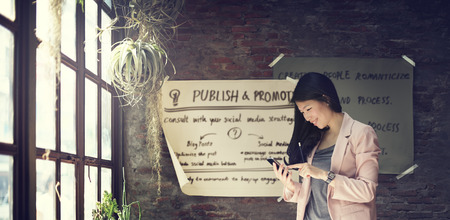massy: Businesswoman Holding Using Smart Phone Working Concept Stock Photo