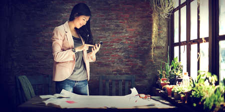 to the secretary: Businesswoman Secretary Using Mobile Phone Concept Stock Photo