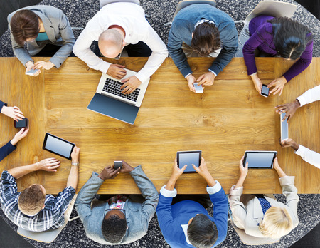 team business: Group of Business People Using Digital Devices Concept Stock Photo