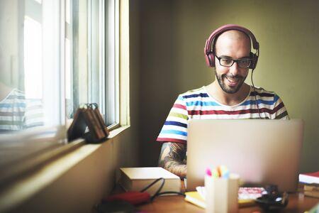 enjoyment: Man Relax Enjoyment Listening Using Laptop Concept