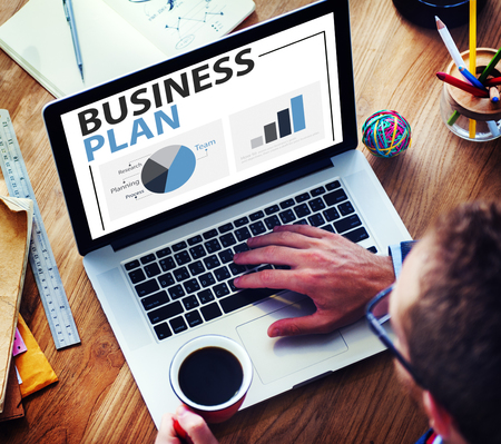 business software: Business Plan Planning Strategy Meeting Conference Seminar Concept Stock Photo
