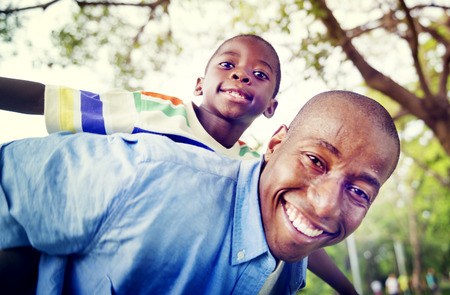 young black man: African Son Dad Piggy Back Family Outdoors Concept