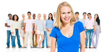 standing out from the crowd: Young Adult Woman Standing Out From Crowd Concept Stock Photo
