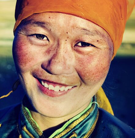 southeast asian ethnicity: Mongolian Woman Traditional Dress Smiling Happiness Concept