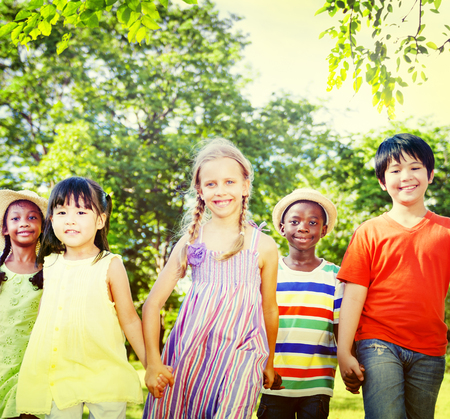 of african descent: Diverse Children Friendship Playing Outdoors Concept Stock Photo