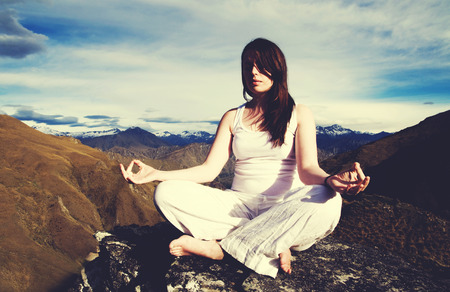 yoga meditation: Woman Sitting Medidating Mountain Range Concept