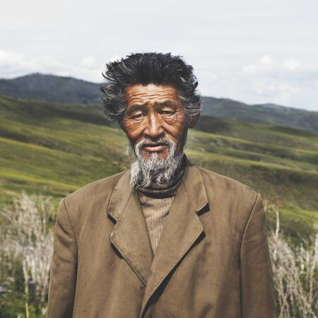 independent mongolia: Portrait Mongolian Man Field Senior Tranquil Solitude Concept Stock Photo
