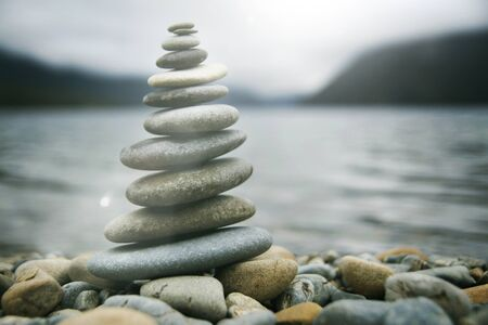 Zen Balancing Pebbles Misty Lake Stone Stack Tranquil Concept