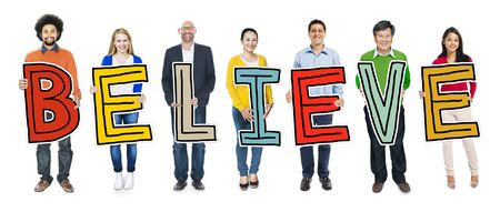 multiethnic: Multiethnic Group of People Holding Letter with Believe Concept