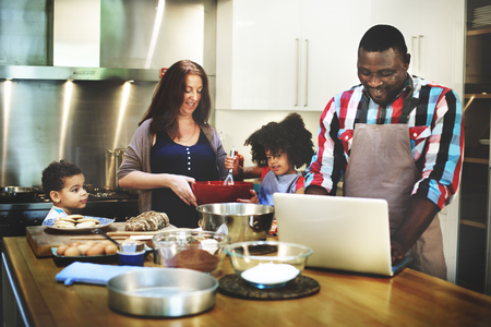 african american mother and daughter: Family Cooking Kitchen Food Togetherness Concept