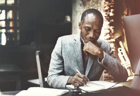 determine: African Man Working Determine Workspace Lifestyle Concept