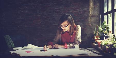 creative designs: Architecture Woman Working Blue Print Workspace Concept