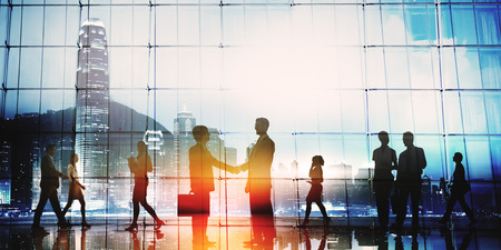 cityscape silhouette: Business People Meeting Commuter Greeting Handshake Concept