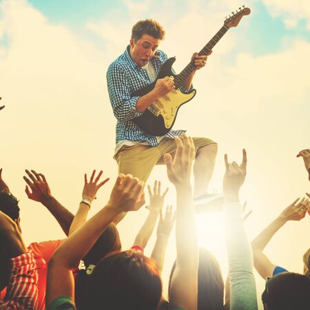 Young Man Guitar Performing Concert Ecstatic Crowds Concept