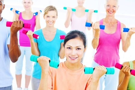 people exercising: Group of People Exercising Fitness Wellbeing Concept