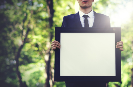 blank  empty: Businessman Holding Picture Frame Copy Space Concept Stock Photo