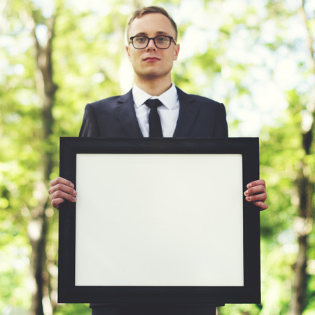 job posting: Businessman Holding Picture Frame Copy Space Concept Stock Photo