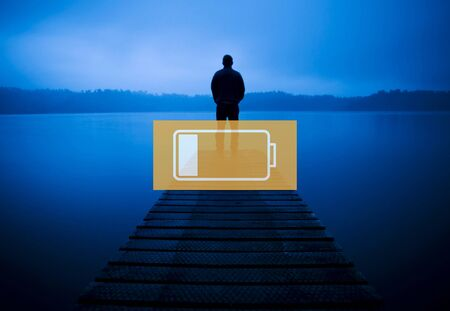 solitude: Low Battery Technology Electricity Exhausted Concept Stock Photo