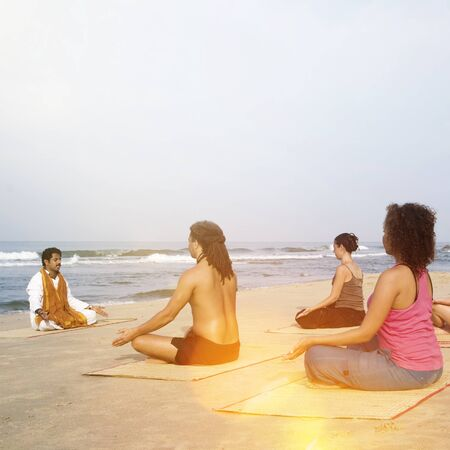 excercise: Yoga Class By The Beach Having Breathing Excercise Concept