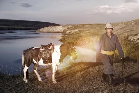 mongolia horse: Horse Man Bringing The Horse Toward The Camera Concept