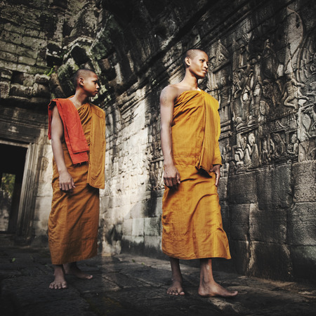 angkor wat: Contemplating Monk in Cambodia Culture Concept