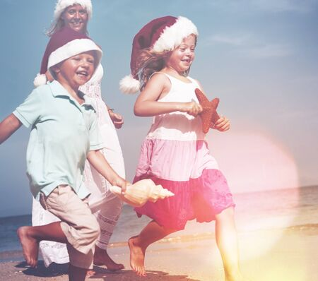 away from it all: Family Christmas Beach Summer Playing Happiness Concept