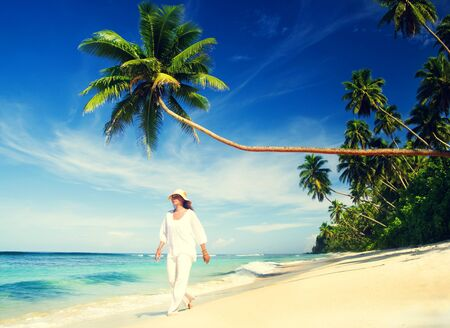 people relax: Woman Walking Tropical Beach Relaxation Summer Concept Stock Photo