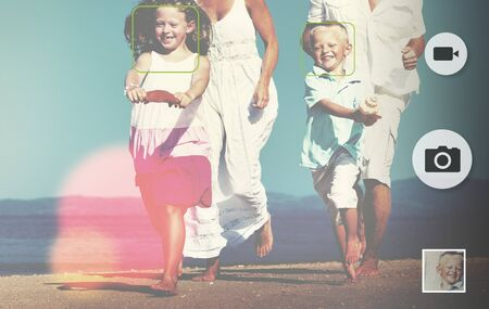 playful: Family Running Playful Vacation Beach Holiday Concept
