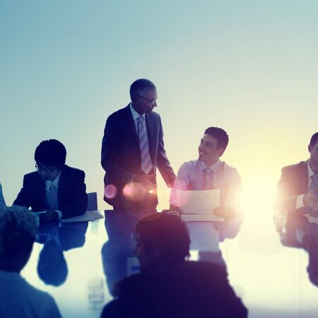 asian business people: Business People Meeting Discussion Back Lit Concept Stock Photo