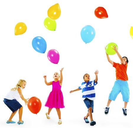 multiethnic: Happy Multi-Ethnic Children Playing Balloons Together