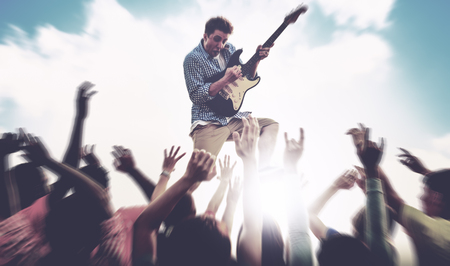 Young Man Guitar Performing Concert Ecstatic Crowds Concept Stock Photo