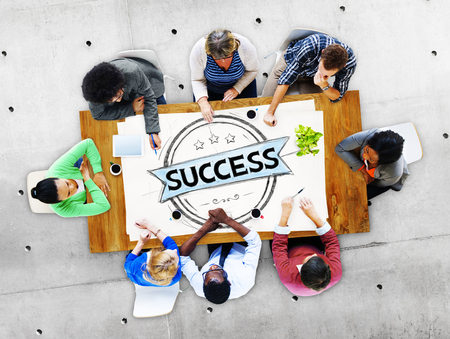People in a meeting with the word success