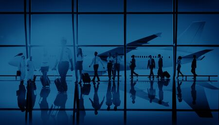 middle air: Business People Traveling Airplane Airport Concept Stock Photo