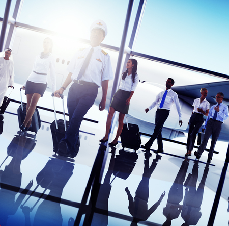 people traveling: Business People Traveling Airplane Airport Concept Stock Photo